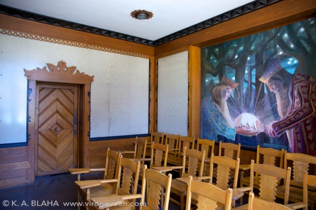 "The Lithuanian room, dedicated in 1940. The walls are woven from linen in the ""The Path of the Birds"" design. Between the angular, abstract carvings and the painting and the walls, this was one of my favorite rooms."