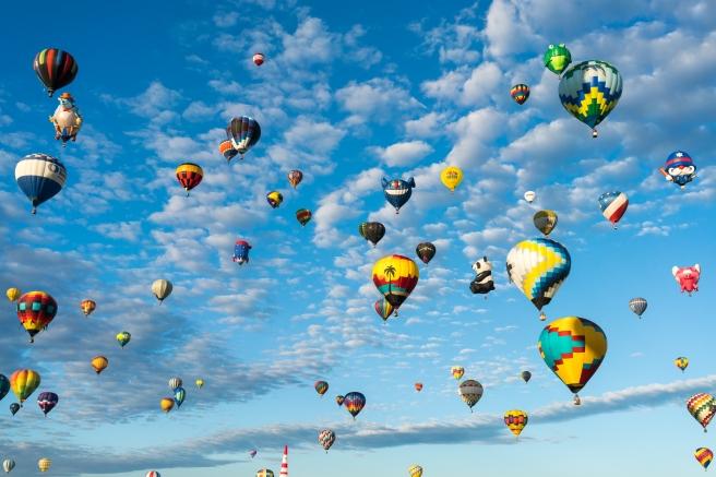 Dozens of balloons in sunlight